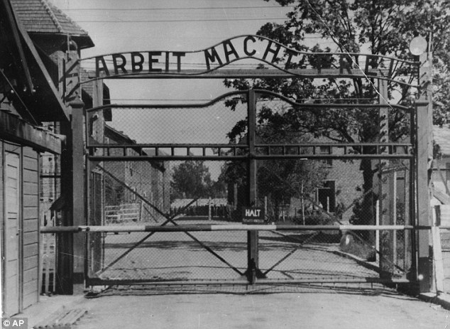 The main gate of the Nazi death camp, where 1.1million people were killed, stated: