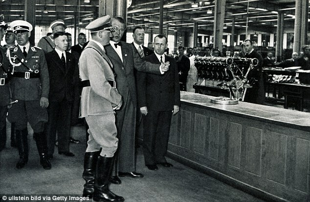 Hitler receives a tour of the BMW AG manufacturing plant by chief executive Franz-Josef Popp in 1936